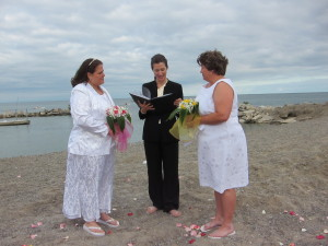 Two New Yorkers getting married at Kew Beach in Toronto's east end just as New York state legalizes same sex marriage.